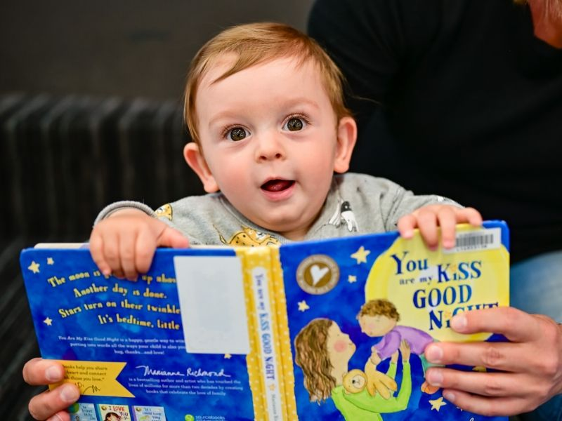 toddler and book