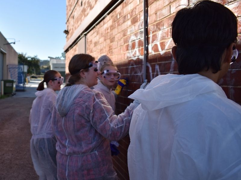 AlburyCity's Youth Councillors used paint and chemicals to clean walls of unslightly graffiti