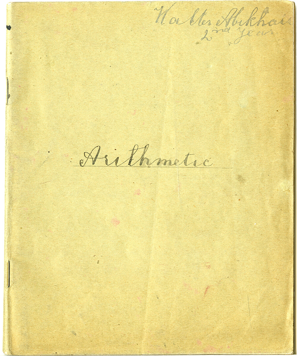 A Light brown paper book, with two staples holding it together and light paper withy faint blue lines inside, 1919. ARM 09.784.
